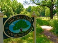 In 2013, New Britain Borough purchased 5.5 acres in Doylestown Township adjacent to the Covered Bridge Park on Keeley Avenue and the Pine Run Reservoir. Formerly part of a farm/orchard, this new Orchard Park completes a 135 acre block of open space, 20 acres of park land, 39 acres of flood control lake and 76 acres of surrounding land.  New Britain Borough and the New Britain Civic Association have agreed to link these two parcels to avoid duplication of parking and other facilities.  In addition, in 2013, the Borough received a PECO Green Region Grant to implement park improvements.  These two events together created the Orchard Park we know and cherish today. Covered Bridge Park park features a playground, a picnic pavilion, a soccer/baseball field, a gazebo and a pond.